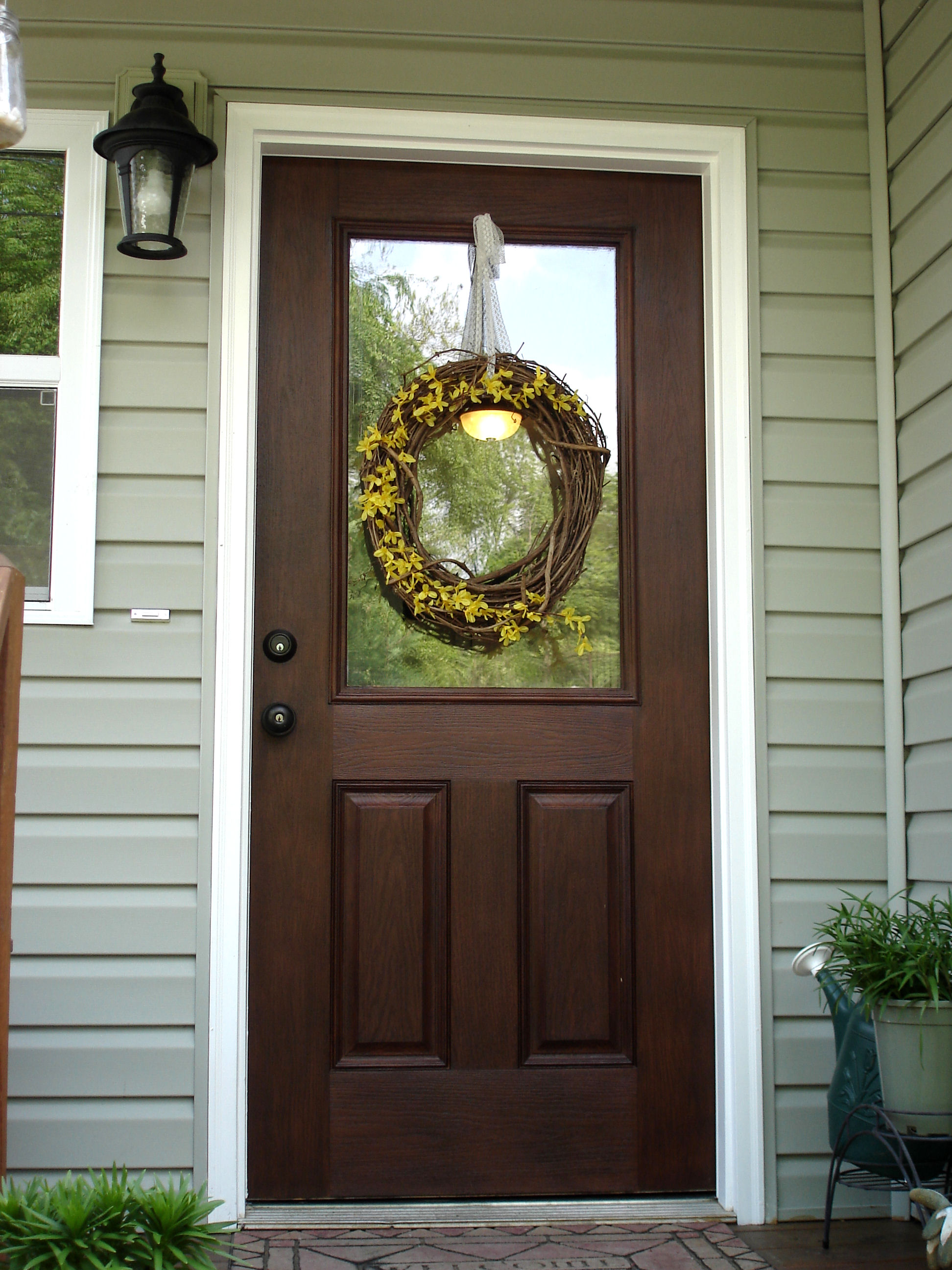 chic wooden door using minwax gel stain plus wreath and white trim board door matched with gray horizontal siding for home exterior design ideas
