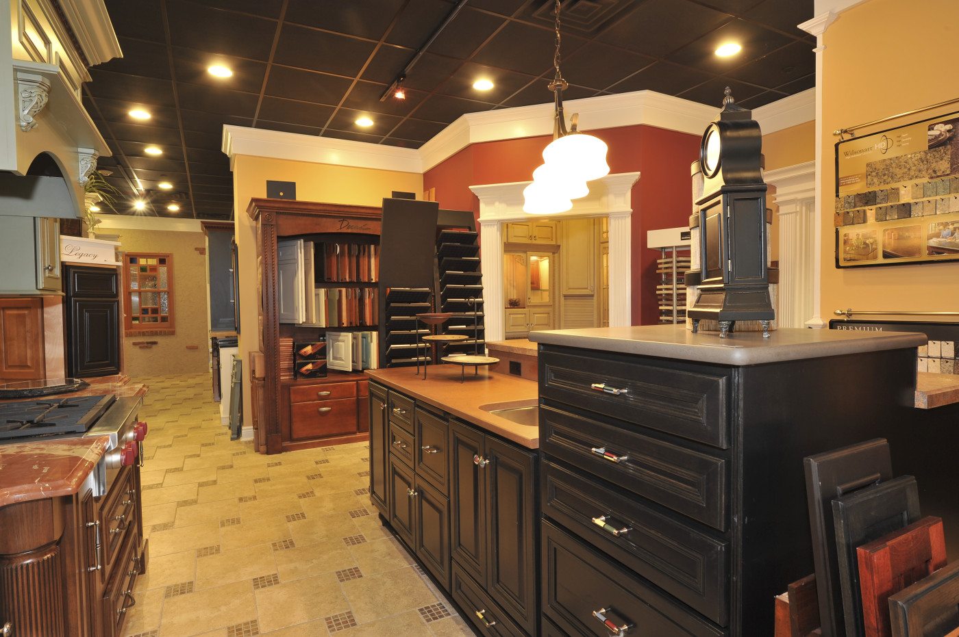 chic wooden kitchen bertch cabinets in black with silver handle and countertop under the pendant lamp for kitchen decor ideas