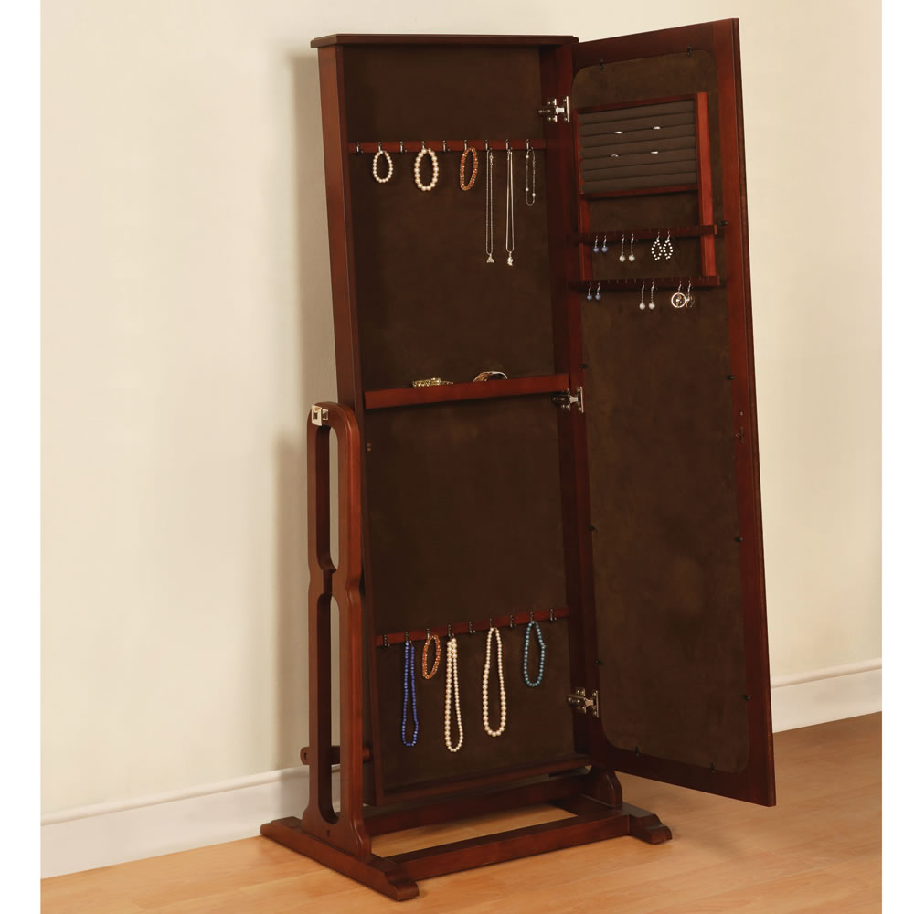 chic wooden standing mirror jewelry armoire in brown before the white wall on wooden floor for living room decor ideas