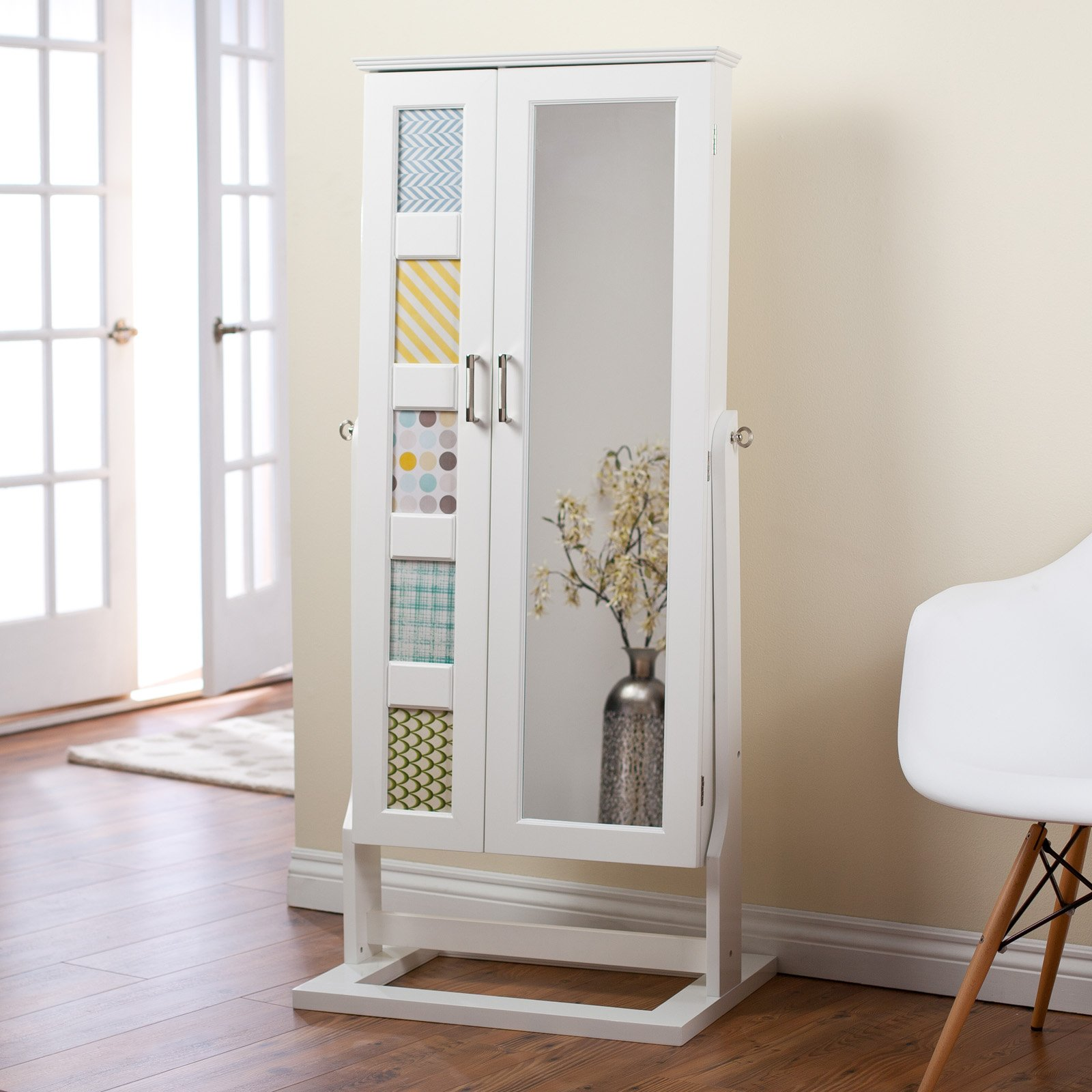 chic wooden standing mirror jewelry armoire in white before the beige wall matched with wooden floor for living room decor ideas
