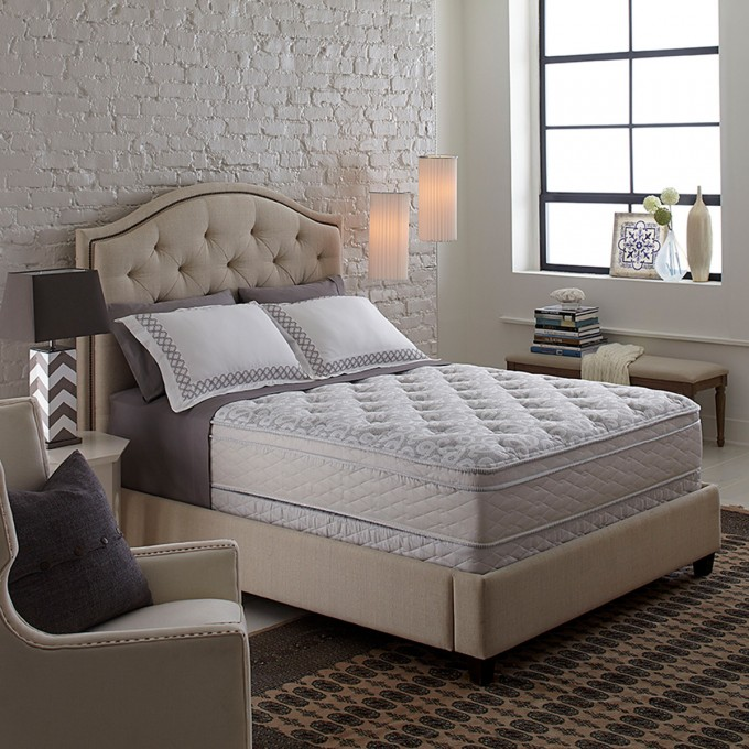 Comfortable Serta Perfect Sleeper Bristol Way Supreme Gel Euro Top King Size Mattress On Beige Bed Plus Pillows On Wooden Floor With Brown Rug Matched With Brick Wall Plus Sofa For Bedroom Decor Ideas