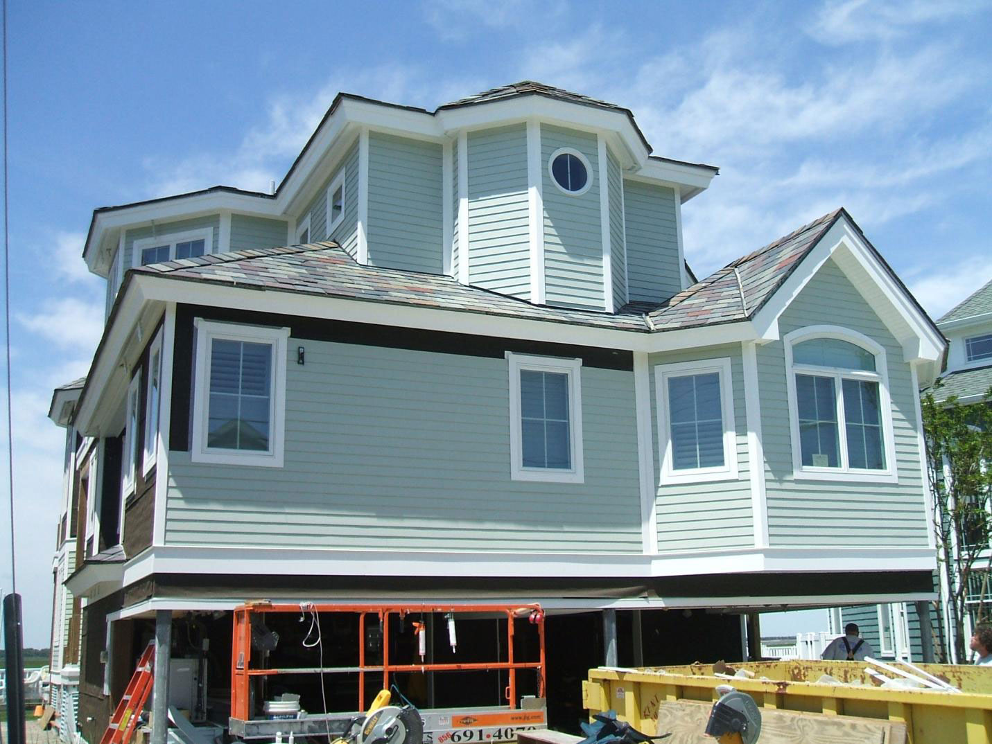 cool hardie plank siding in white matched with white trim board plus glass window for home exterior design ideas