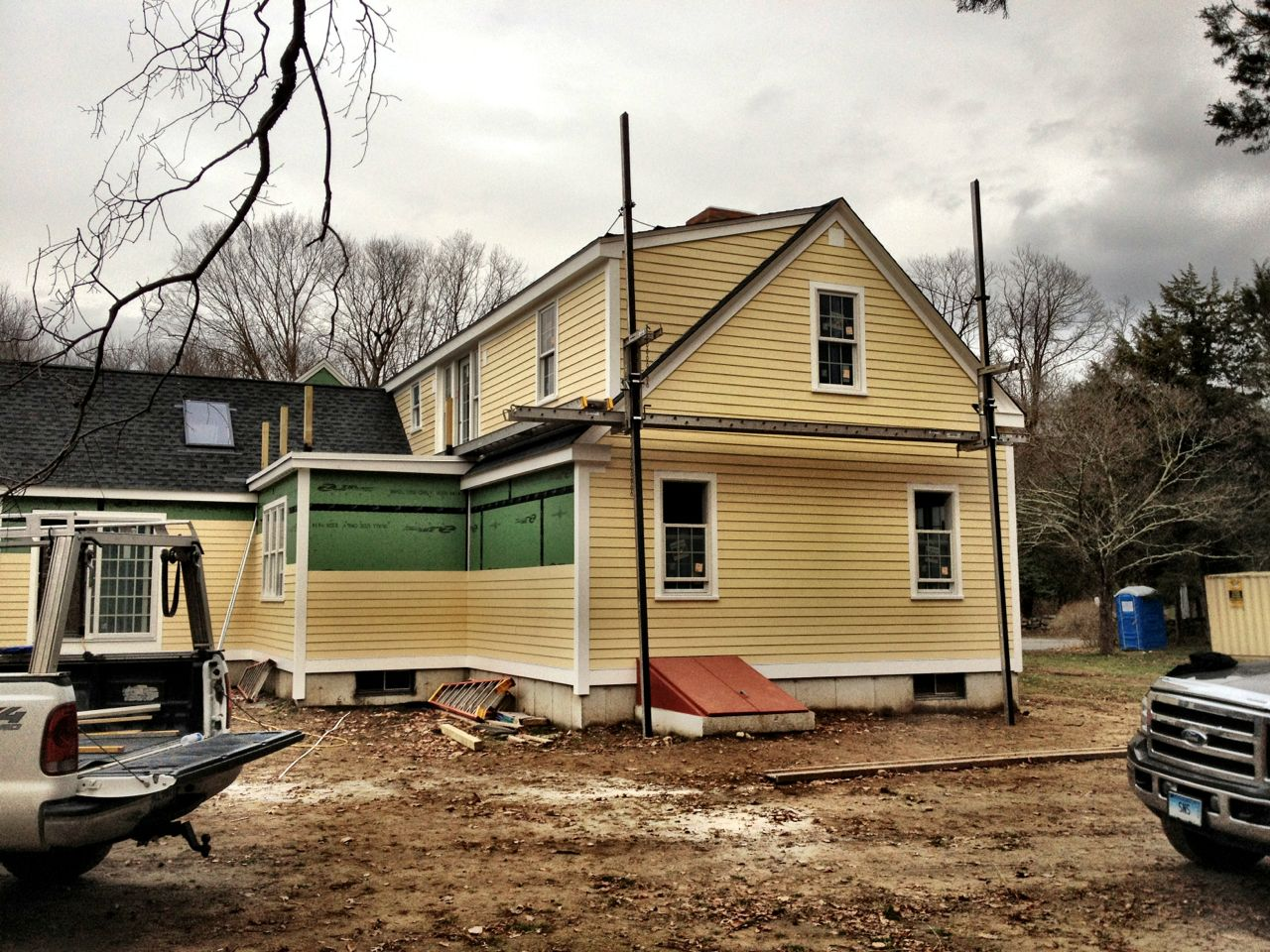 cool horizontal hardie plank siding in yellow with white trim board and single hung window for home exterior design ideas