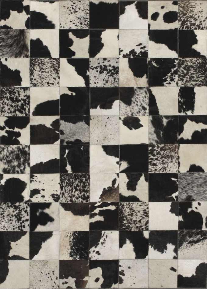 Cowhide Patchwork Rug In Black And White With Checked Motif For Floor Decor Ideas