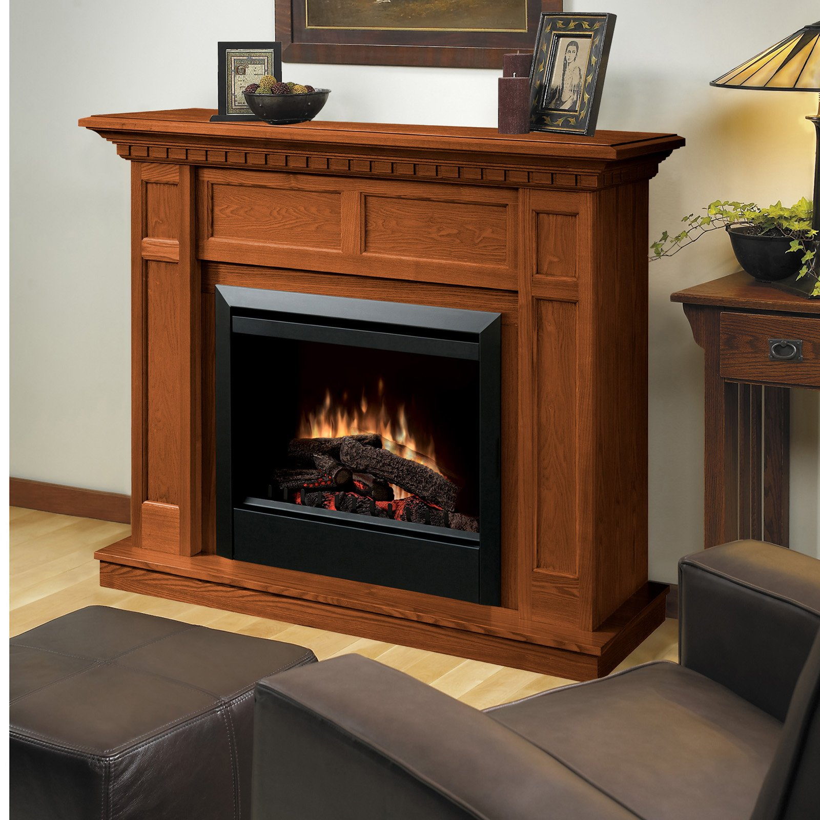 cozy black framed dimplex electric fireplaces with wood mantel kit before the white wall matched with wooden floor plus leather sofa for family room decor ideas
