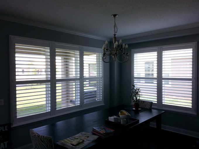 Cozy Dining Room Design With Sunburst Shutters On Gray Room Plus Wooden Dining Table Set Under The Chandelier Ideas