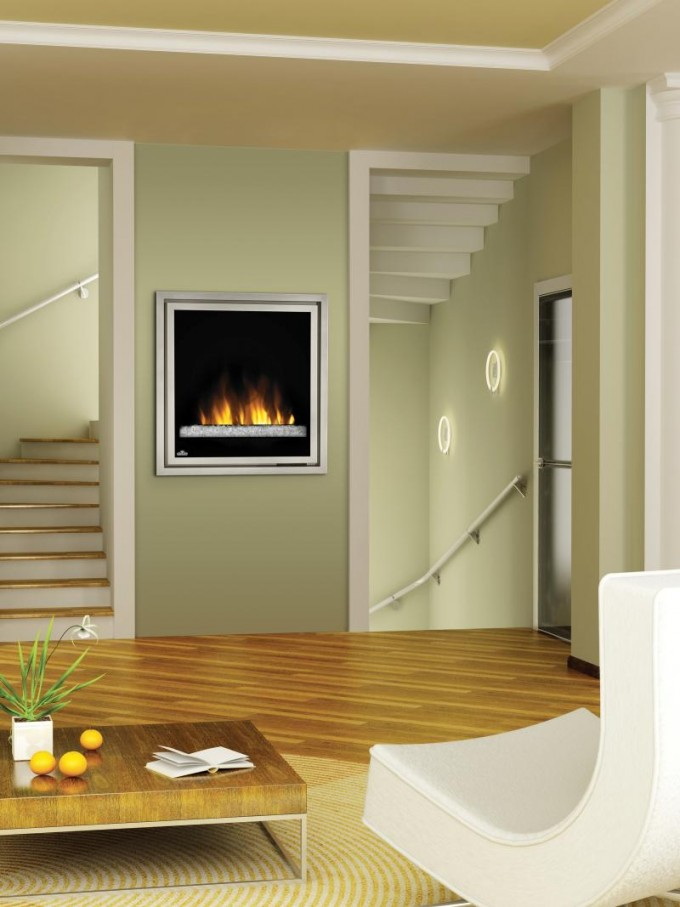 Cozy Electric Napoleon Fireplace On Olive Wall With White Trim Board Matched With Wooden Floor With Rug And Sofa For Family Room Decor Ideas