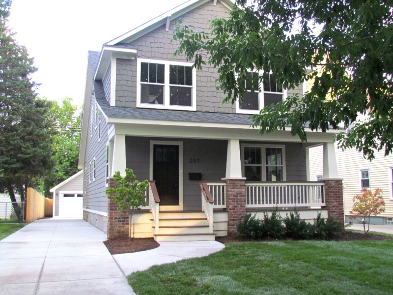 cozy horizontal hardie plank siding in gray with smooth trim board door and window plus white wooden railing for home exterior design ideas