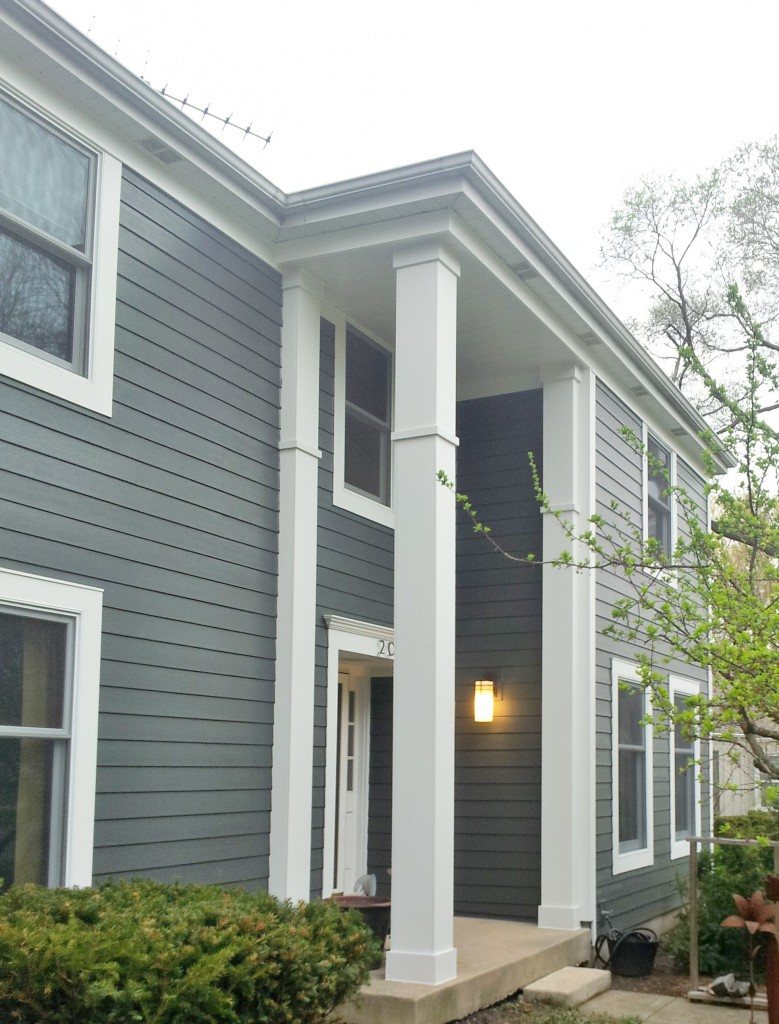 cozy horizontal hardie plank siding in gray with white smooth trim board and glass window for home exterior design ideas