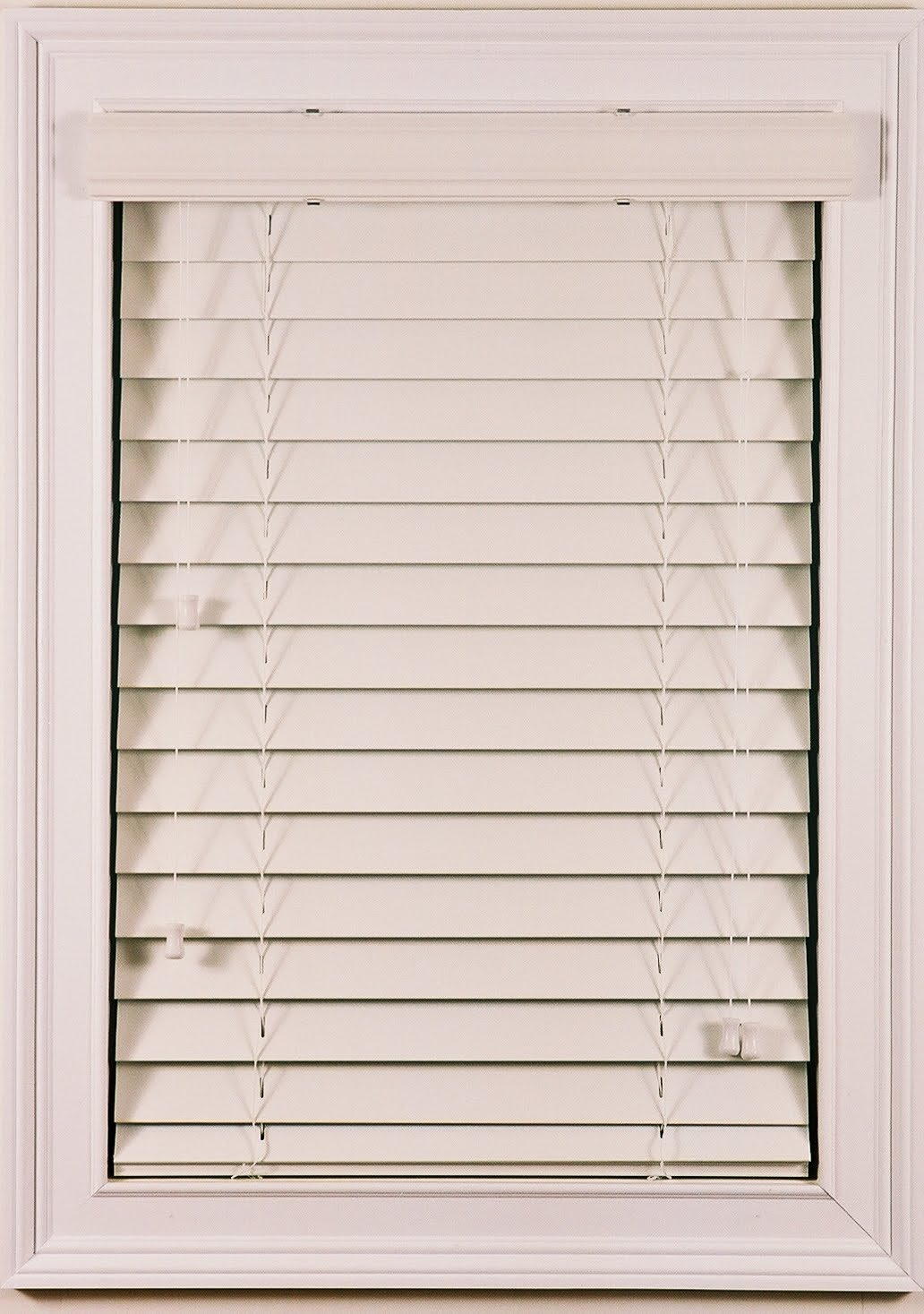 cozy white faux wood blinds on white window with trim board for home design ideas