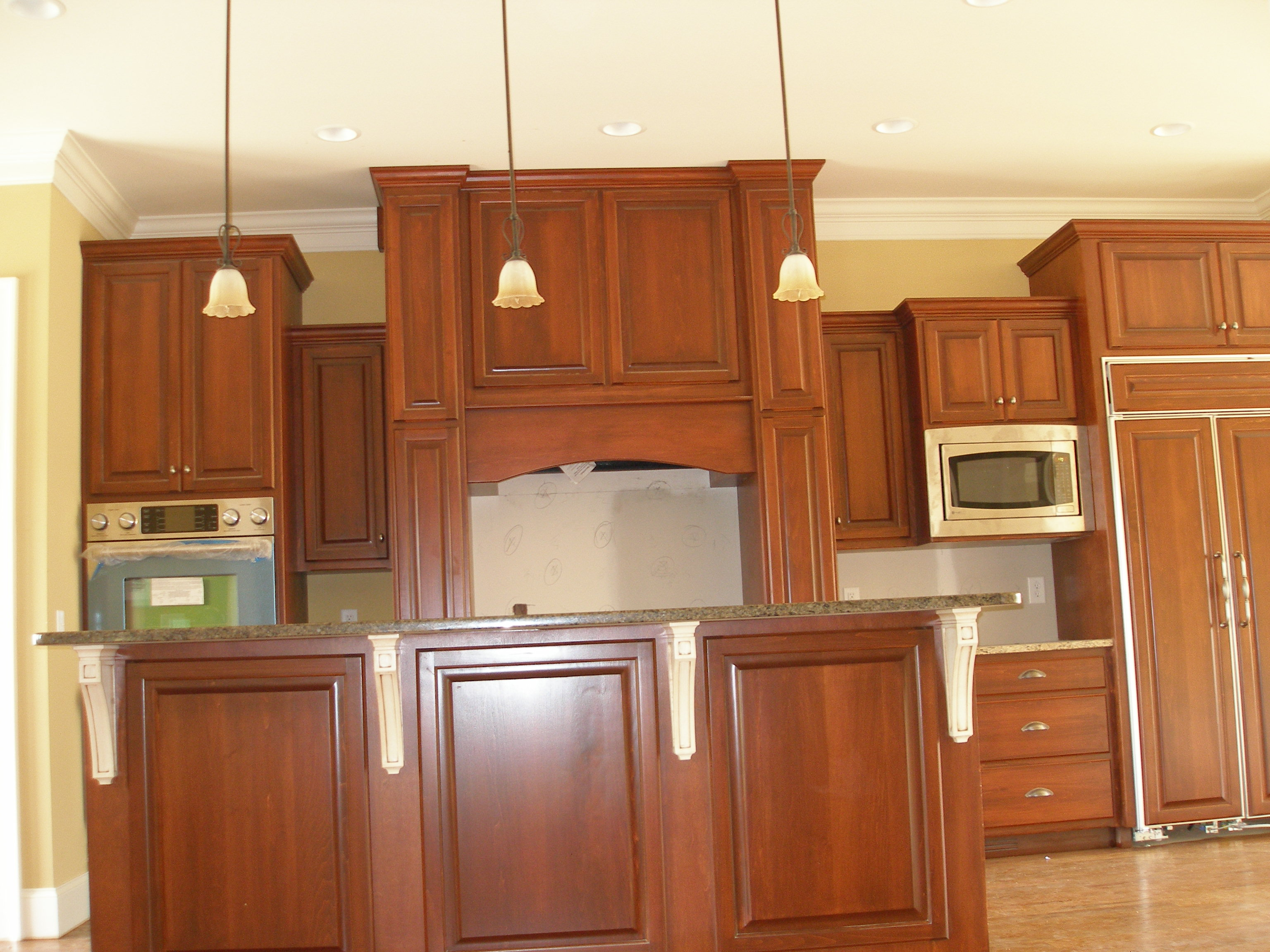 Custom kitchen american woodmark cabinets in peru with granite countertop and oven plus chandelier for kitchen decor ideas