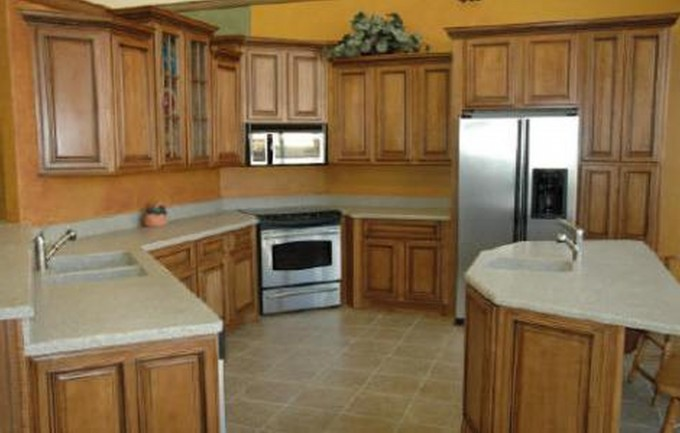 Custom Kitchen American Woodmark Cabinets In Peru With White Countertop And Stove Plus Fridge On Beige Tile Floor For Kitchen Decor Ideas