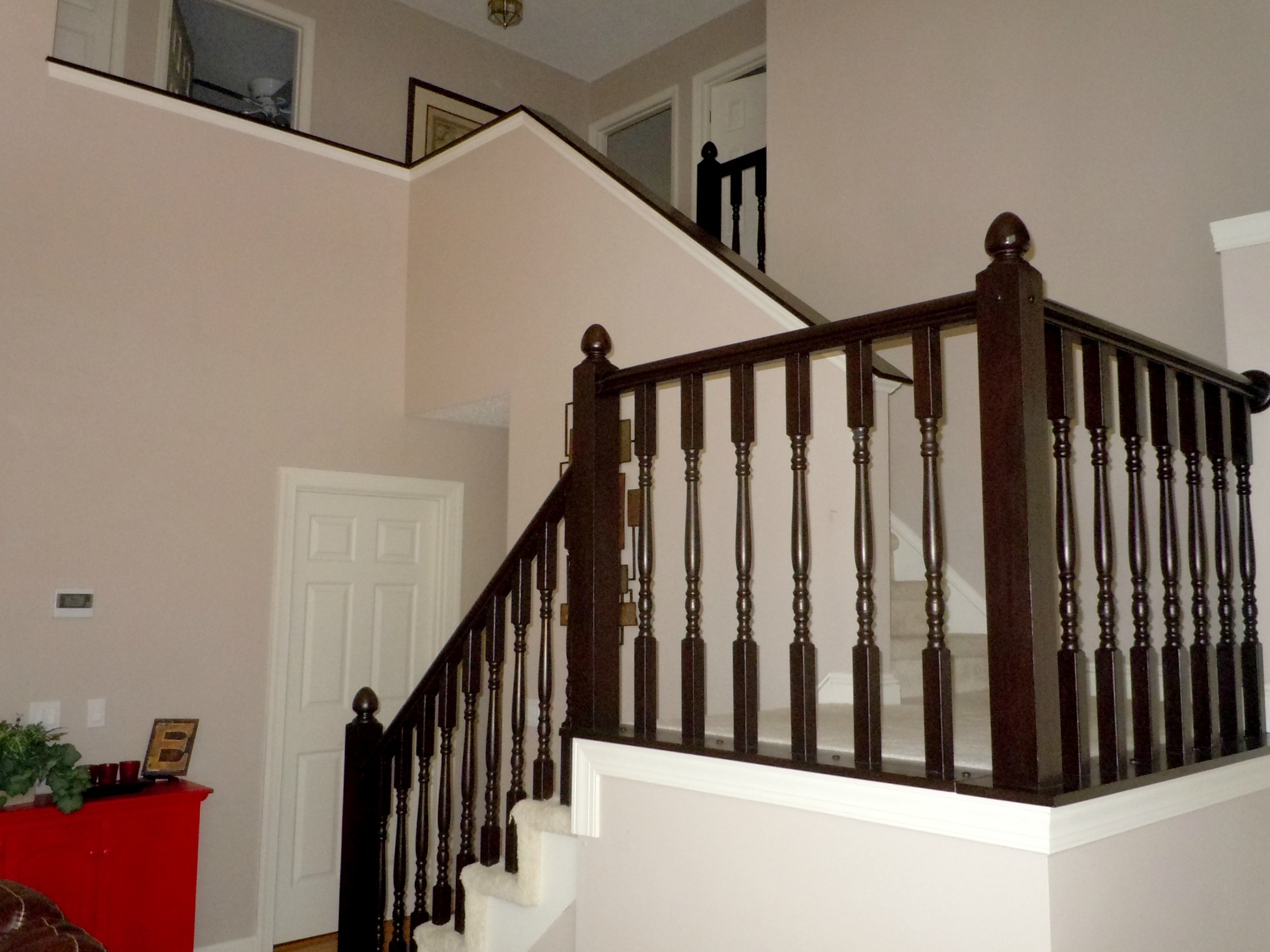 DIY Stair Banister Makeover Using general finishes java gel stain in espresso matched with beige wall for home interior design ideas
