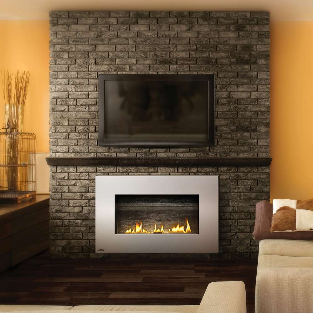 electric napoleon fireplace and television on brick mantel kit matched with yellow wall and wooden floor plus sofa set for family room decor ideas