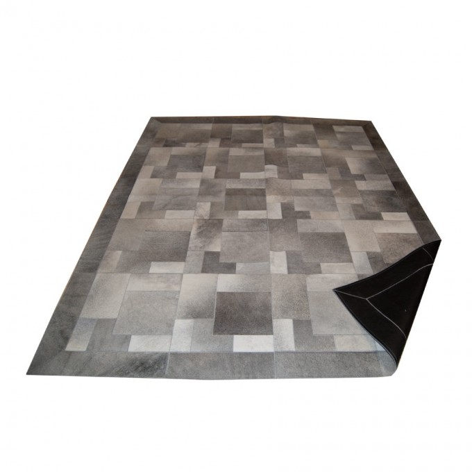 Elegant Cowhide Patchwork Rug In Grey With Puzzle Motif For Floor Decor Ideas