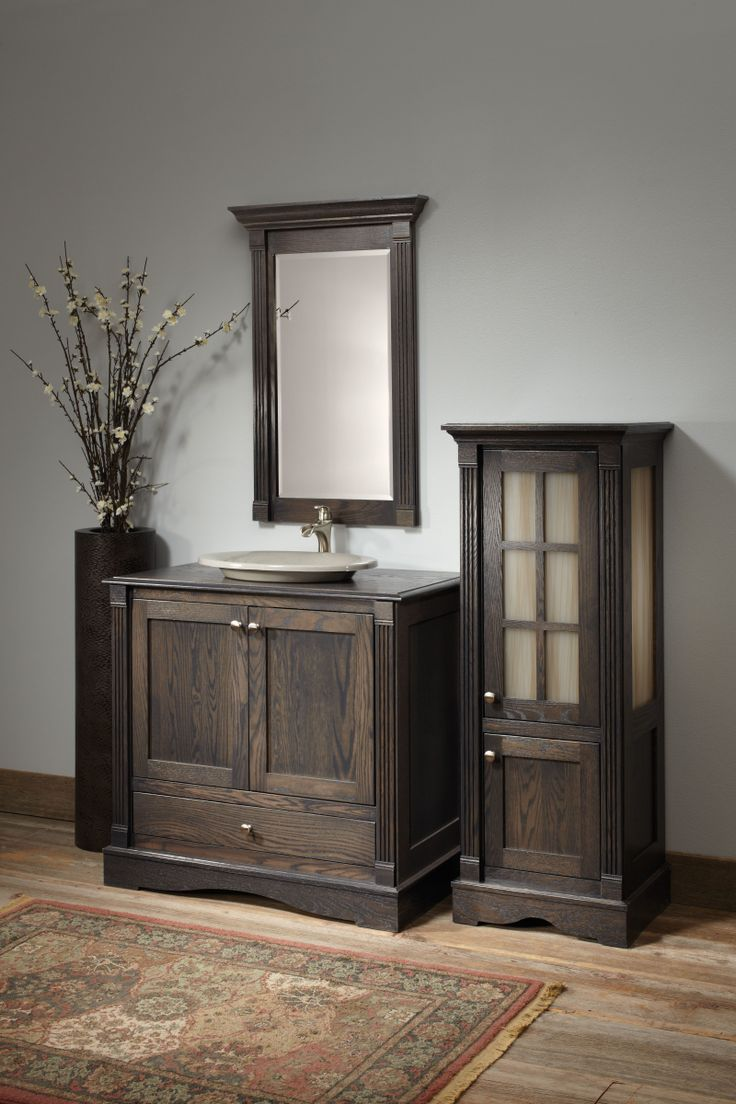 elegant wooden bathroom bertch cabinets before the gray wall matched with wooden floor with floral rug for bathroom decor ideas