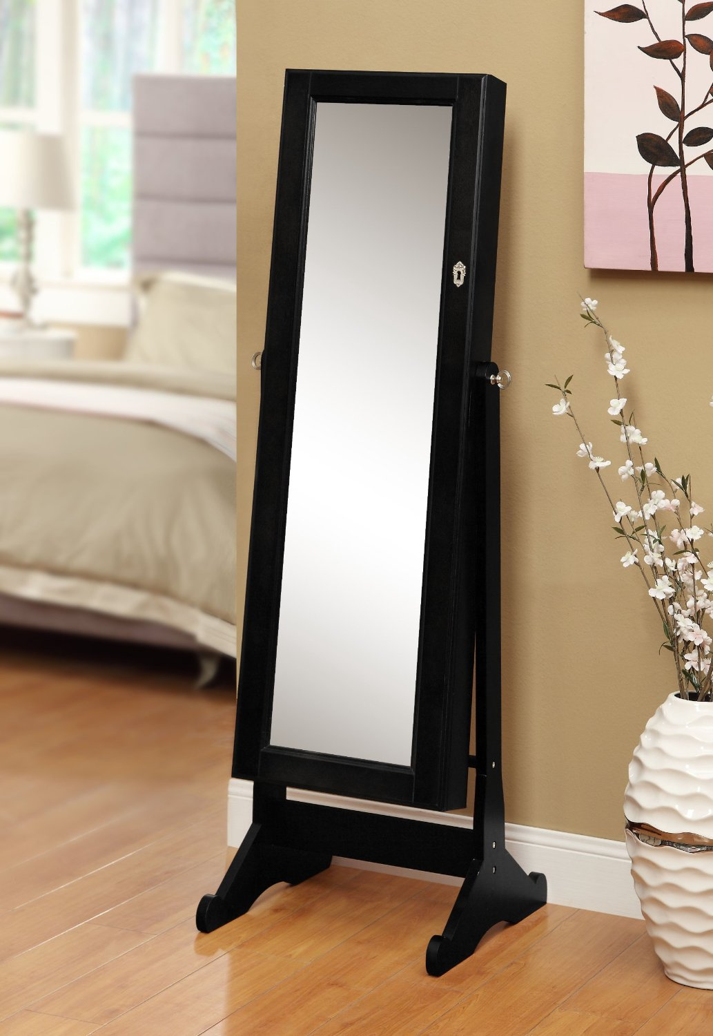 fancy standing mirror jewelry armoire in black before the tan wall matched with wooden floor plus bed for bedroom decor ideas