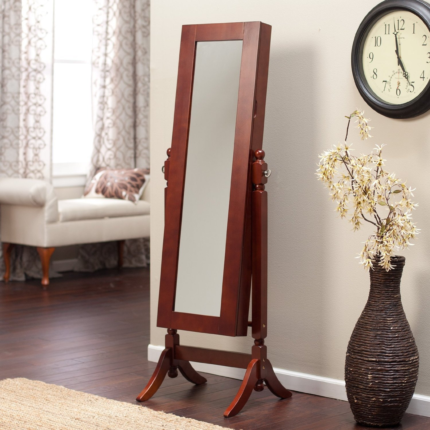 fancy wooden standing mirror jewelry armoire in brown before the beige wall matched with wooden floor with beige rug for living room decor ideas