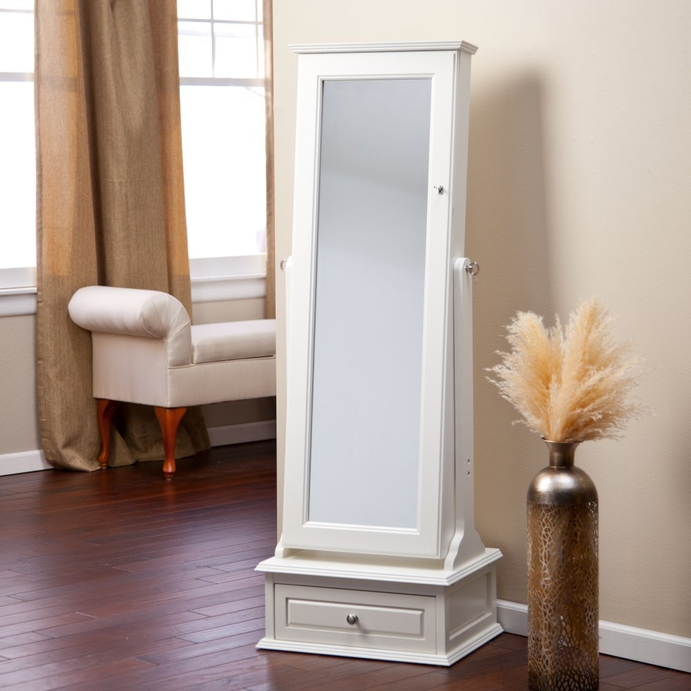 fancy wooden standing mirror jewelry armoire in white with drawer at bottom before the beige wall matched with wooden floor for living room decor ideas