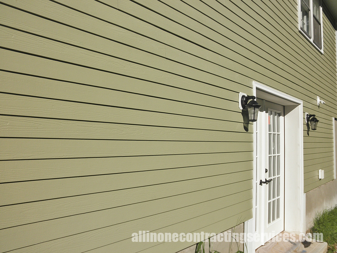 fantastic horizontal hardie plank siding in olive with white door and trim board plus light for home exterior design ideas