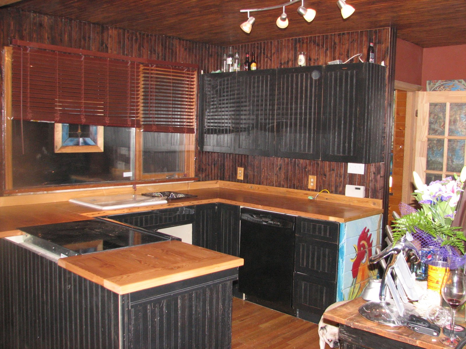 fantastic kitchen American Woodmark Cabinets in black with wooden counrtop with oven for wood theme of kitchen decoration