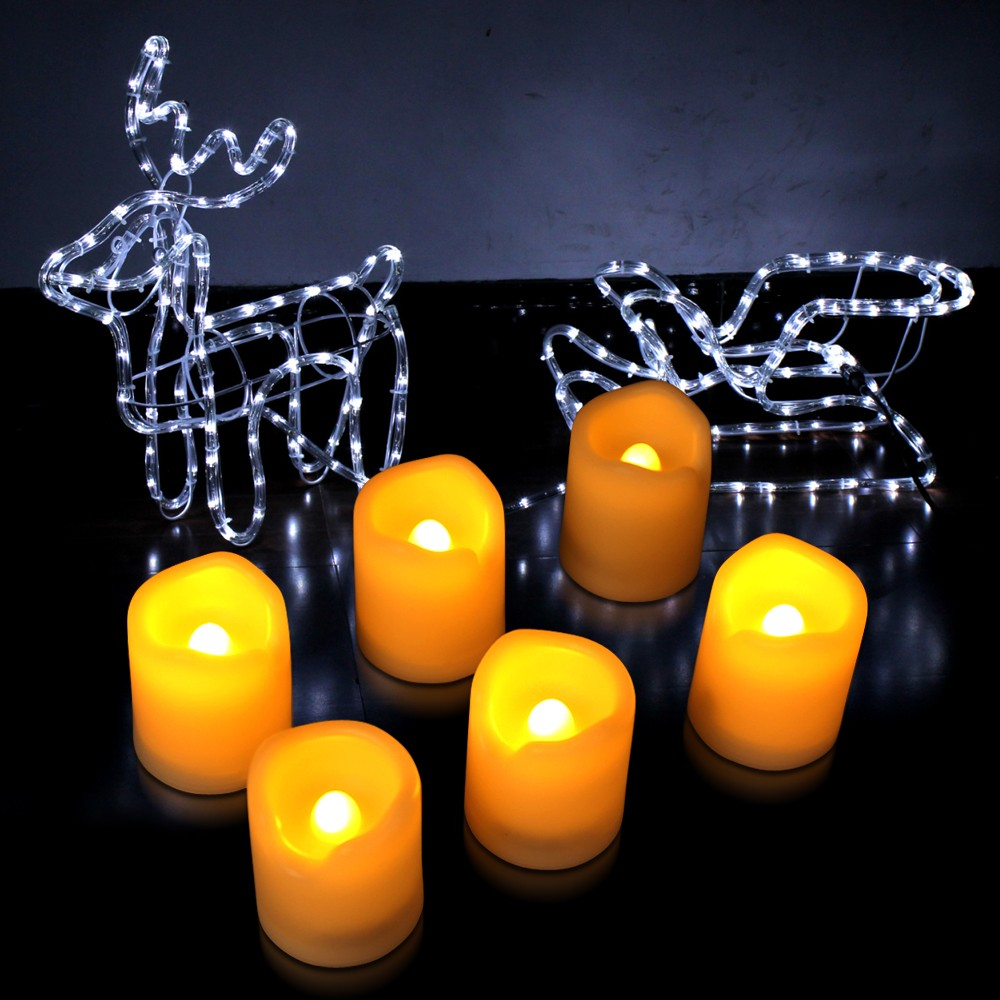 flameless candles with timer before the gray siding with wreath for home decoration ideas