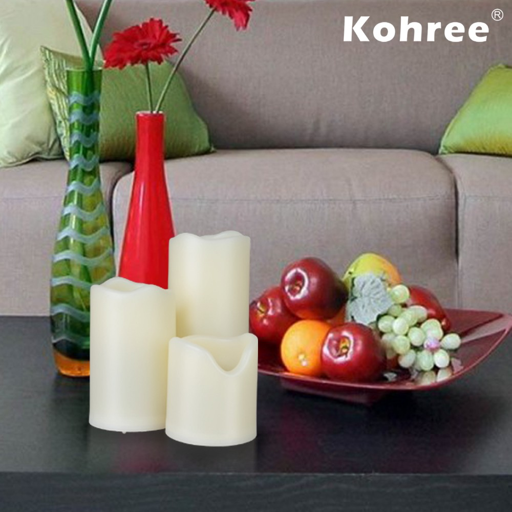 flameless candles with timer set in three on wooden table before the sofa for living room decoration ideas