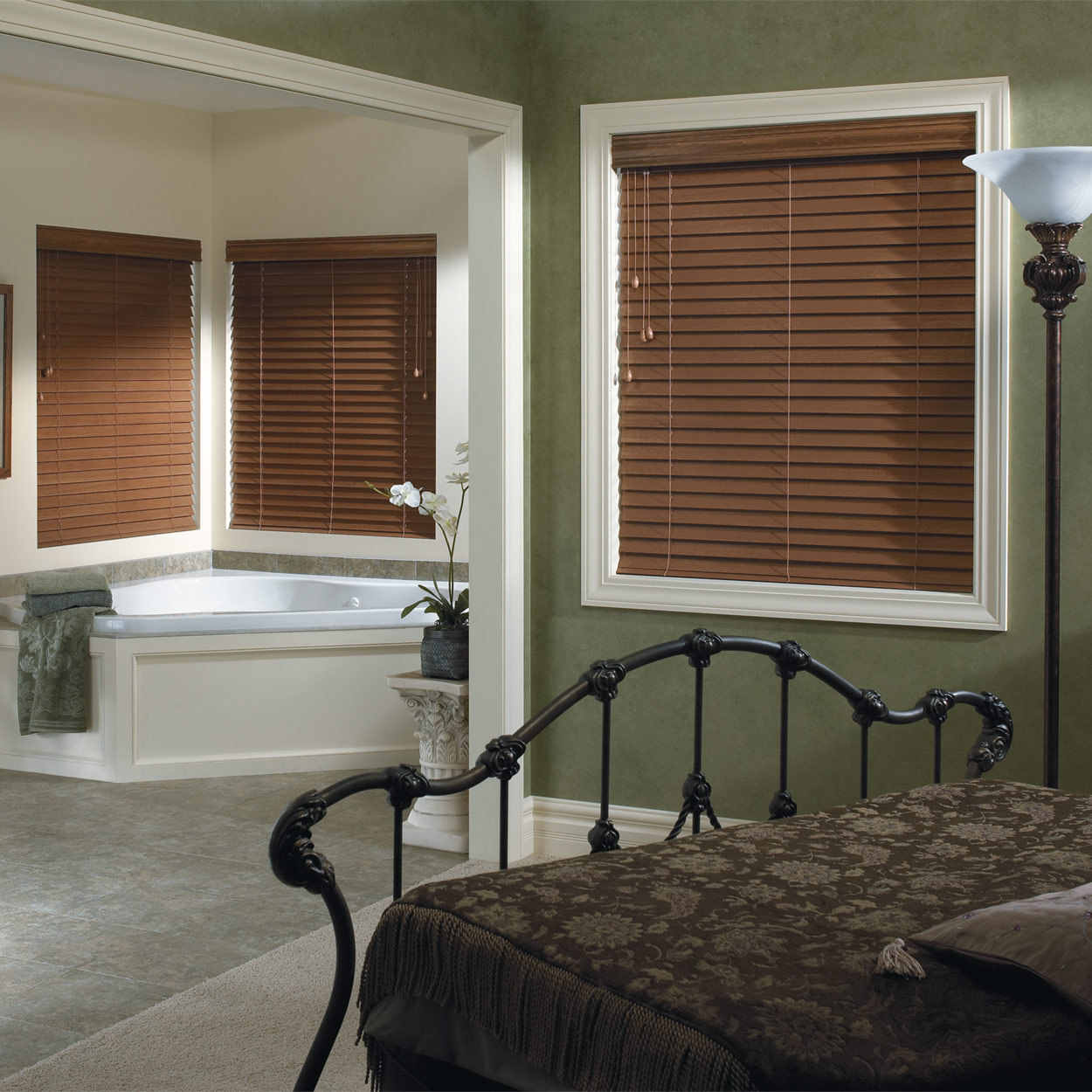 glass window with trim board and brown faux wood blinds on dark olive wall matched with tile floor plus bed for bedroom decor ideas