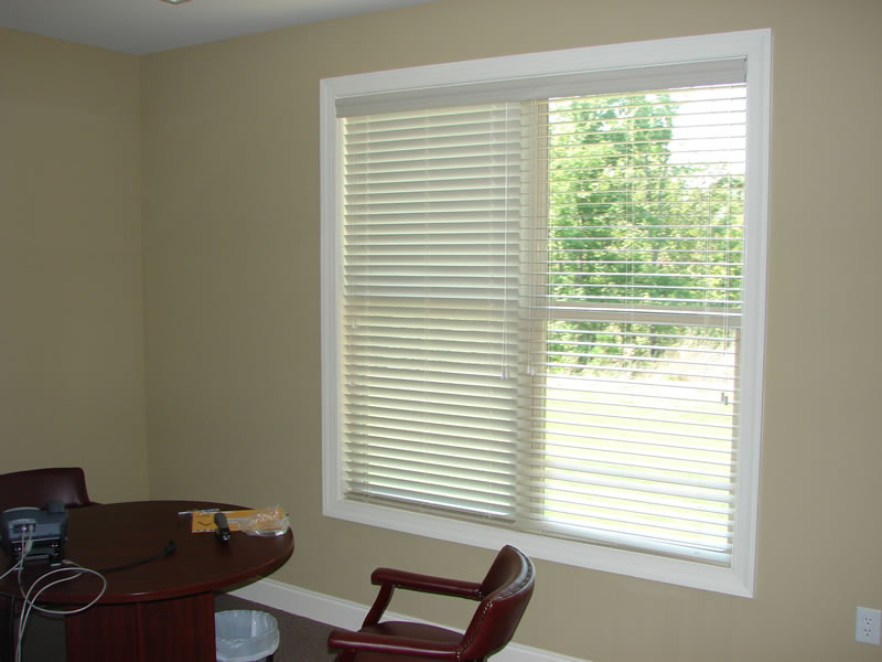 glass window with trim board and white horizontal faux wood blinds for home interior design ideas