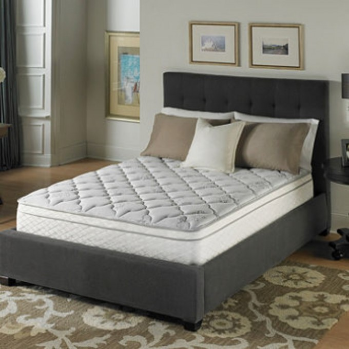 Gray Bed With Serta Perfect Sleeper Mattress Plus Pillows On Wooden Floor With Floral Rug Plus Nightstand And Table Standing Lamp For Bedroom Decor Ideas