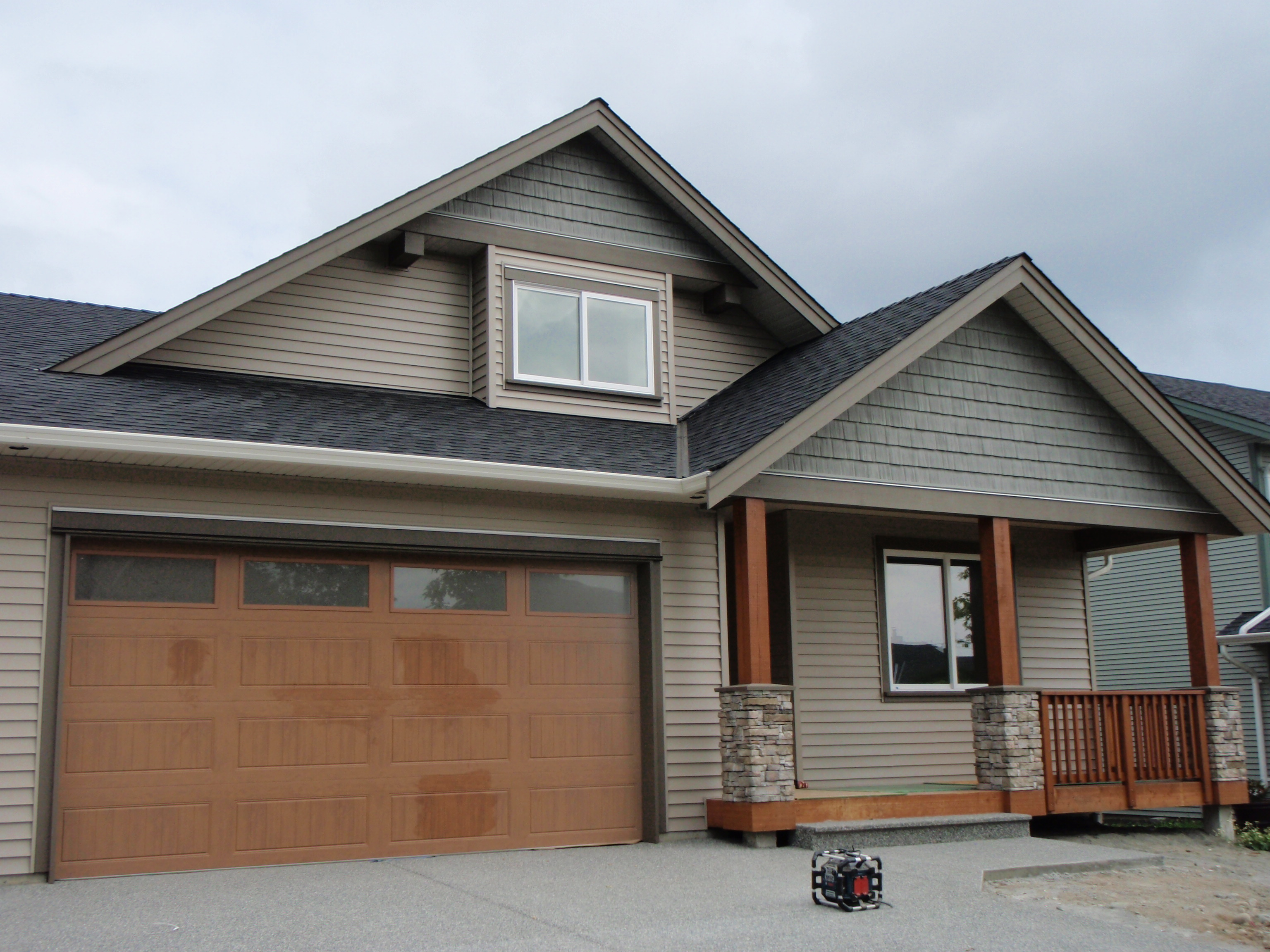 great hardie plank siding in white with black roof and wooden garage door in brown for home exterior design ideas