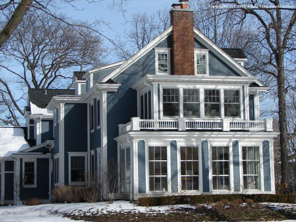 great home exterior design with blue horizontal hardie plank siding and white trim board plus glass windows ideas