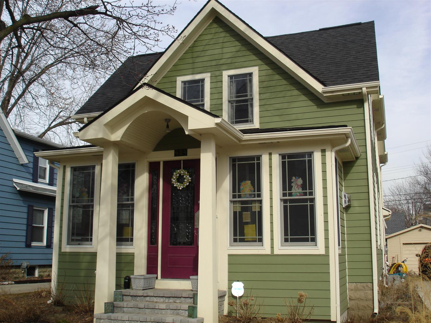 great horizontal hardie plank siding in green with white trim board and glass window plus wooden door for home exterior design ideas