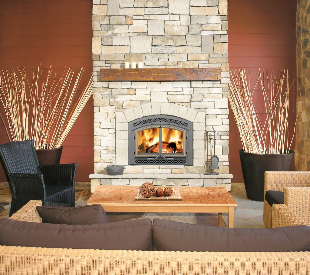 great napoleon fireplace with stone mantel kit matched with brown wall plus rattan sofa set for family room decor ideas