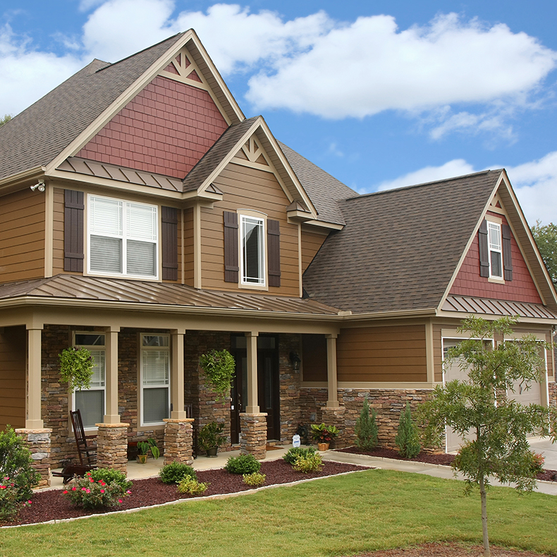 horizontal hardie plank siding in brown with natural stone siding for home exterior design