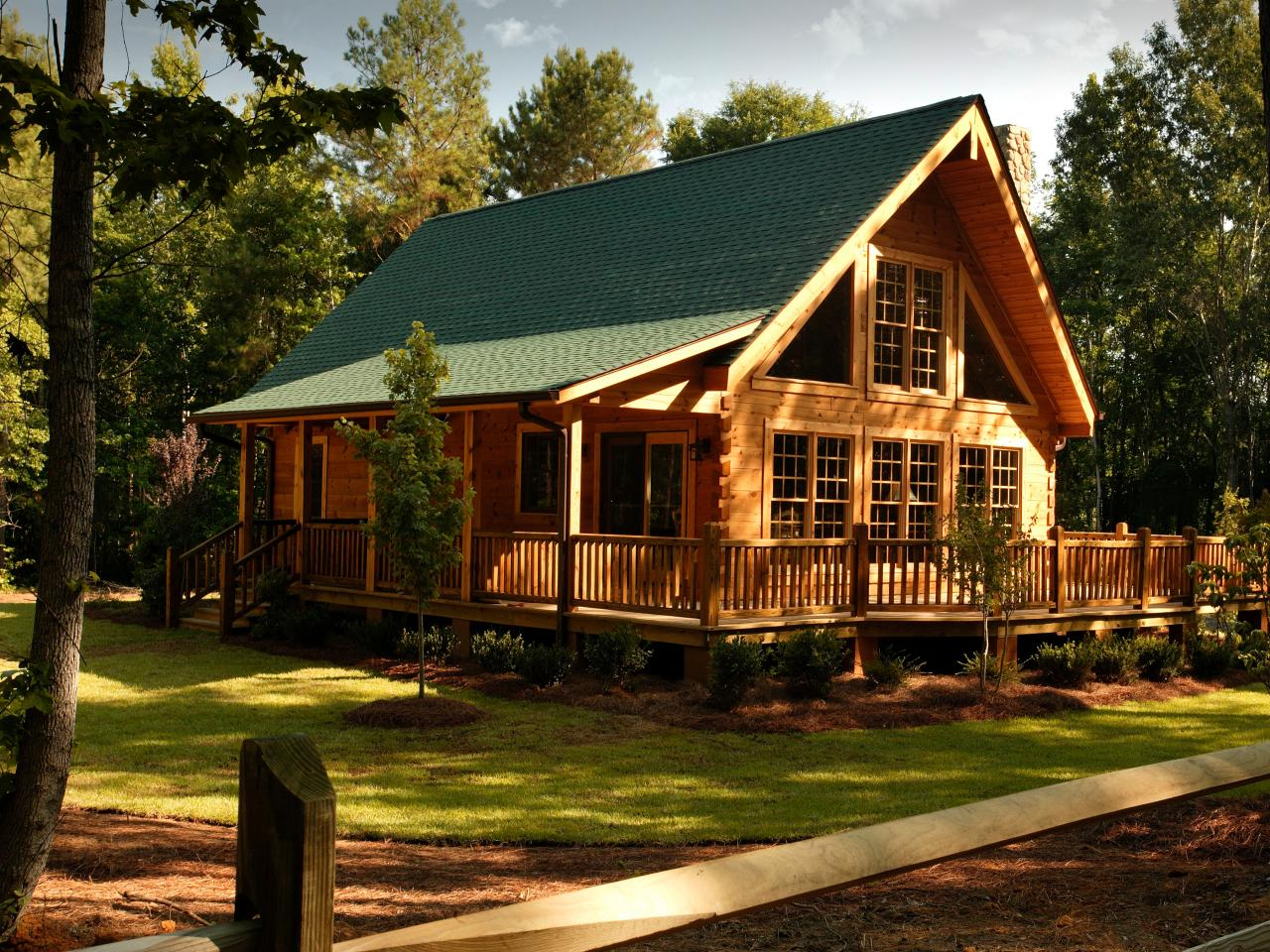 inspiring exterior design of Southland Log Homes with green roof and single hung windows plus door and railing ideas