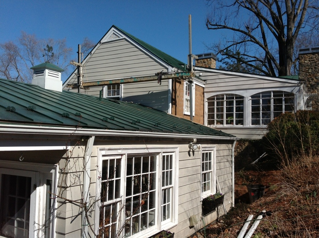 inspiring home exterior design with horizontal hardie plank siding in white and glass window plus green roof ideas
