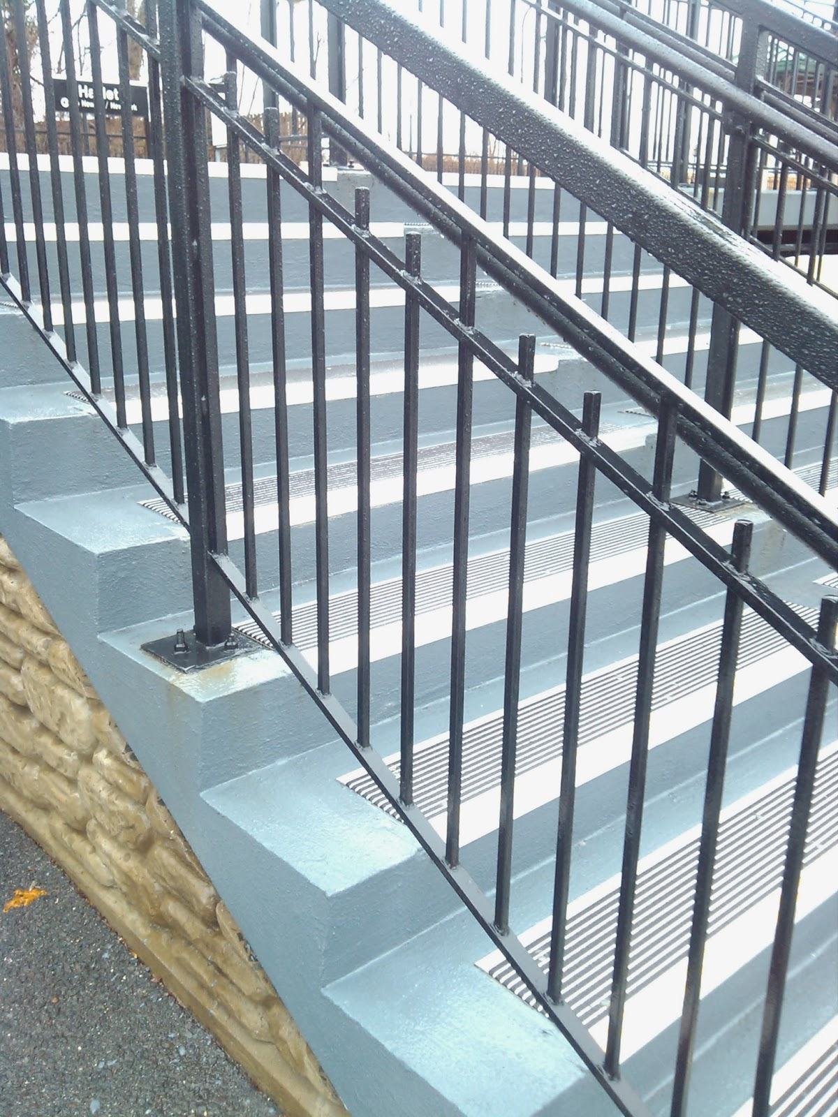 inspiring safety railing using non slip stair treads matched with black metal railing ideas