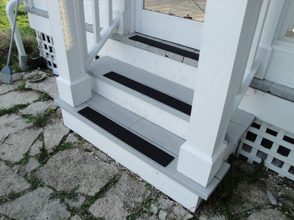 inspiring wooden stair with black non slip stair treads and white railing for home design ideas