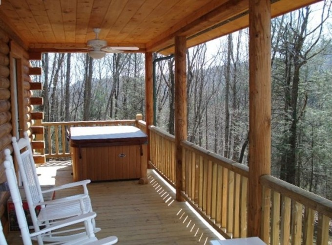 Interesting Deck Of Southland Log Homes With White Wooden Rocking Chairs And Fan Ceiling Ideas