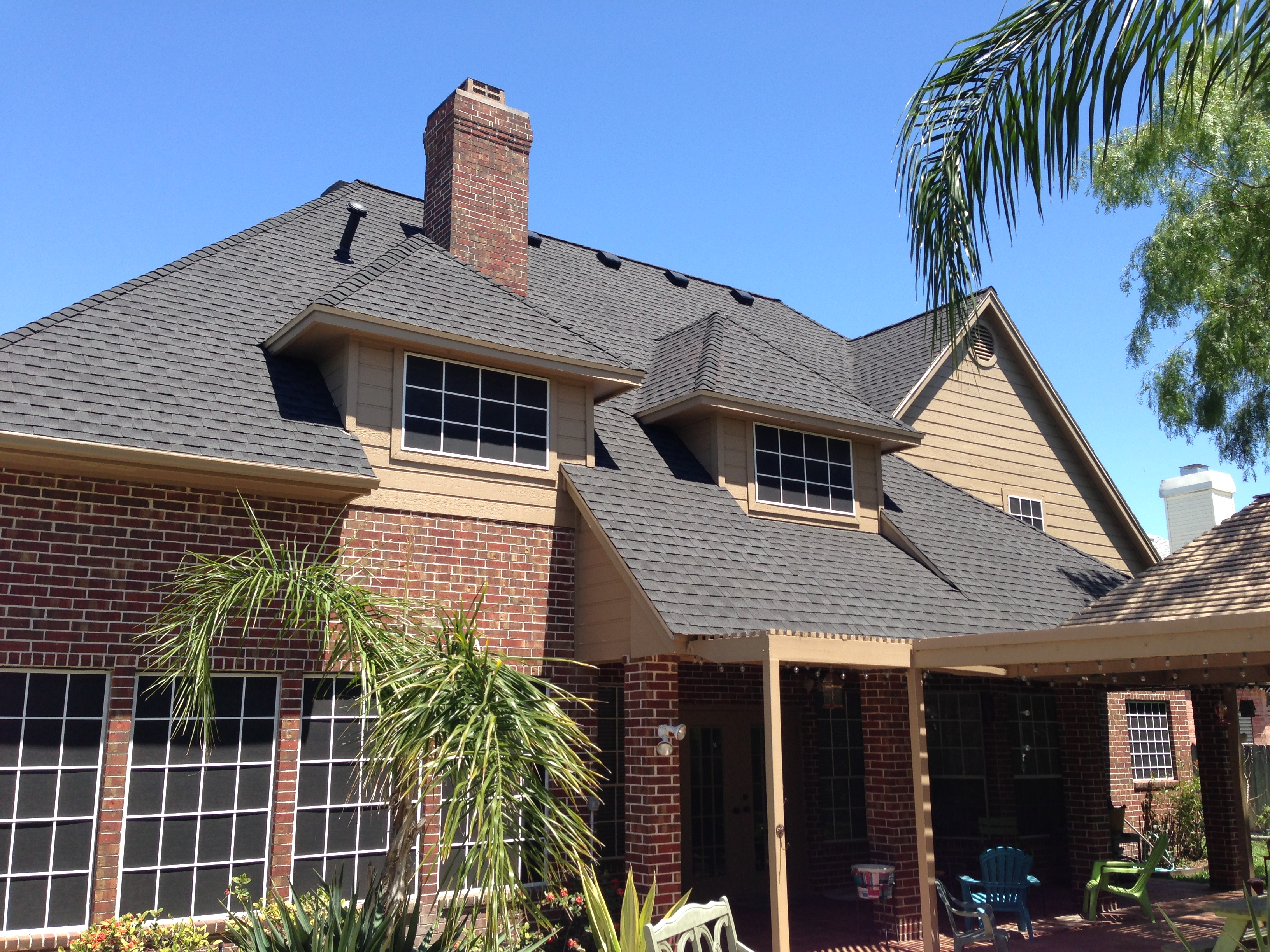 interesting home exterior design using dark gaf timberline hd roofing with brick siding and framed glass window ideas