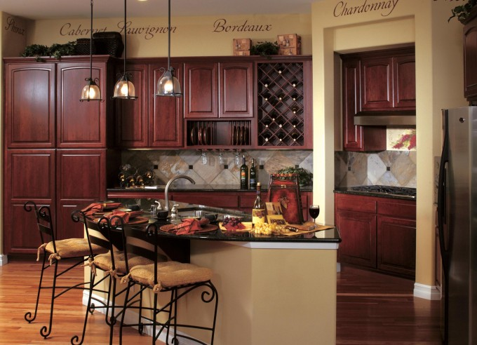 Interesting Kitchen American Woodmark Cabinets In Natural Brown Wood Color With Black Granite Countertop And Stove Plus Bottles Stand And Also With Kitchen Island For Kitchen Decor Ideas