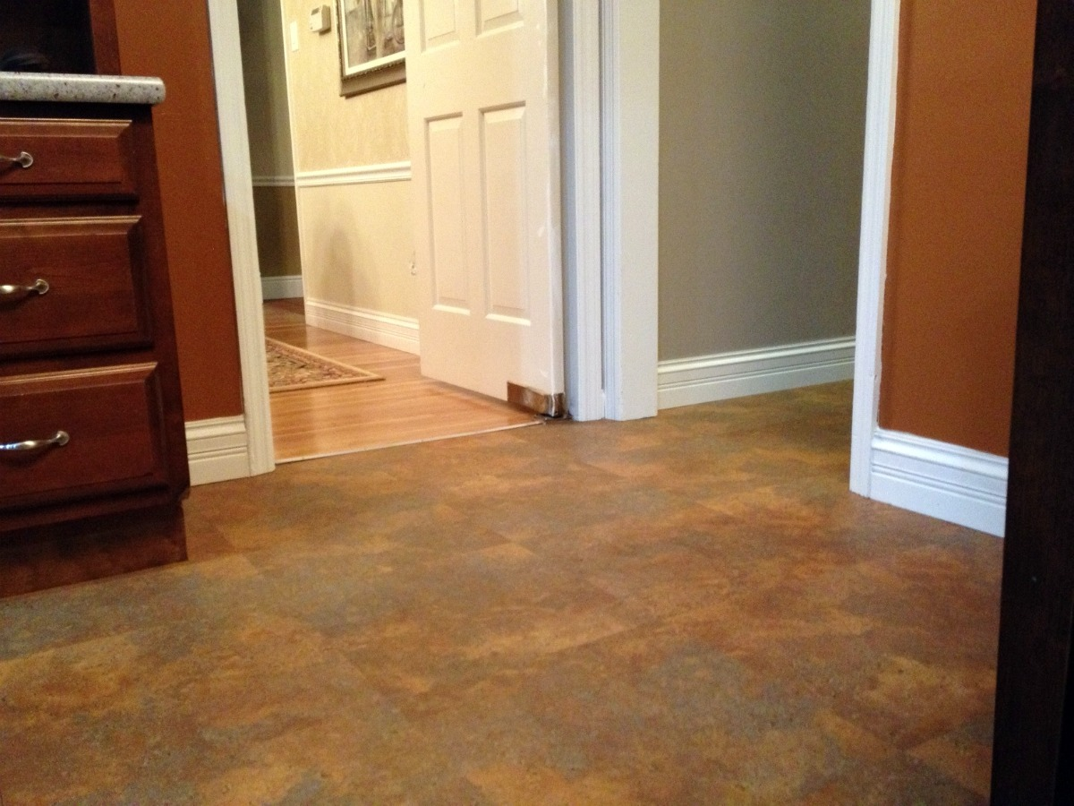 Konecto Flooring with white baseboard molding and white door for home interior design ideas