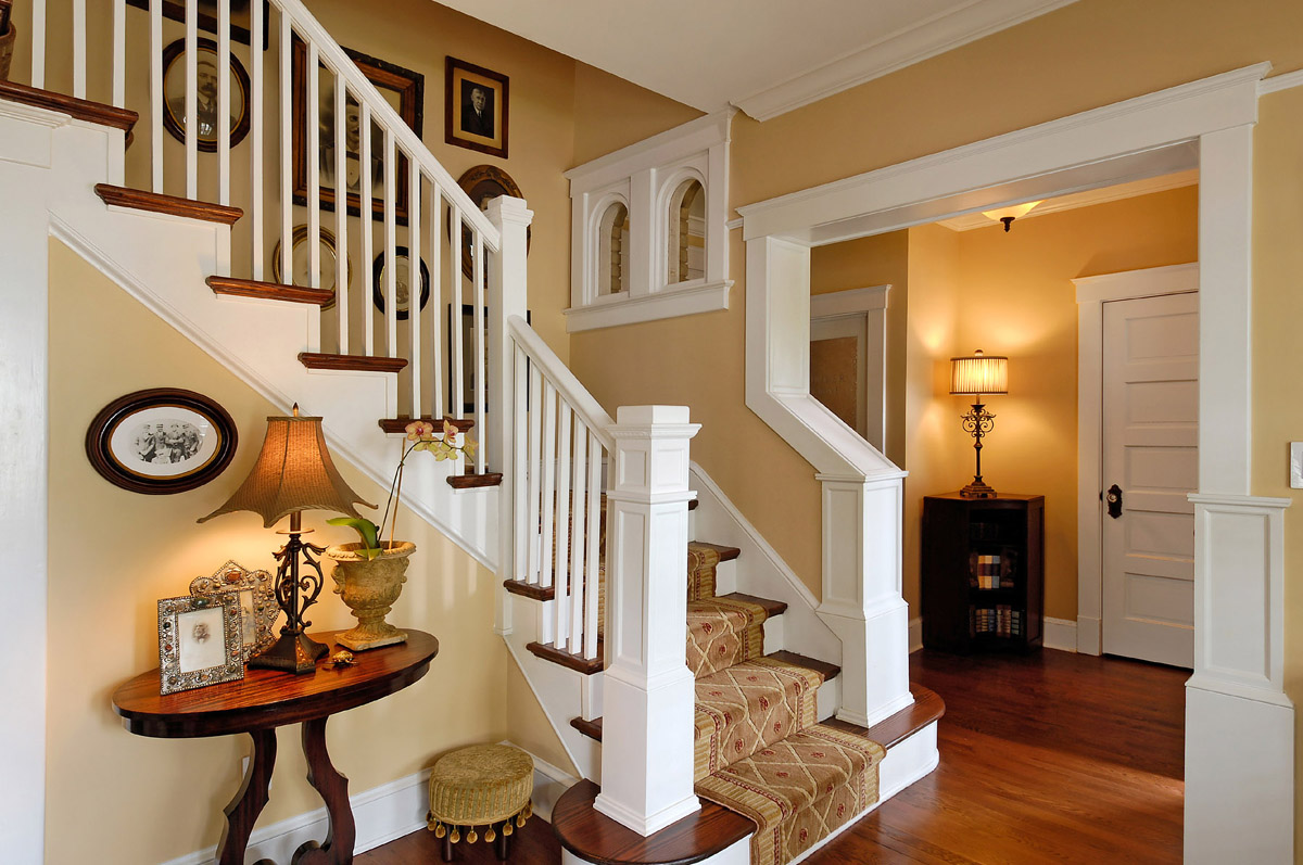 Konecto wooden floor matched with beige wall plus luxury stair with rug for home interior design ideas