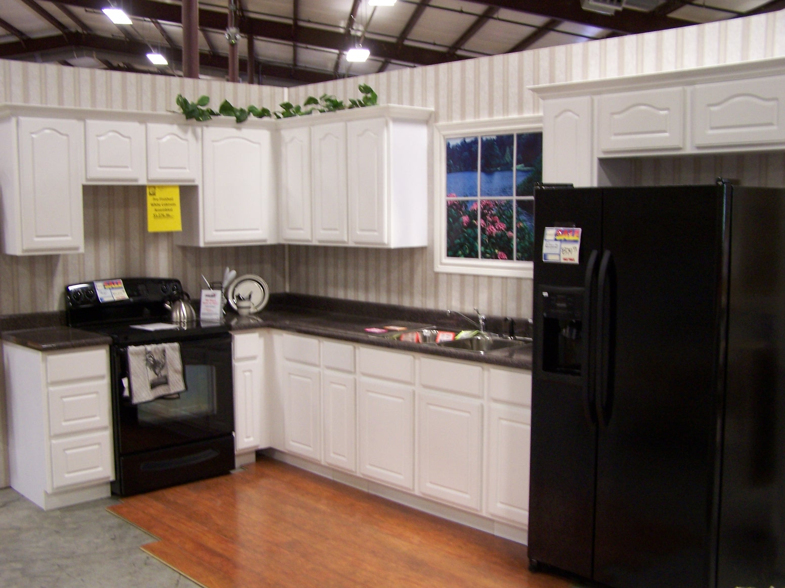 Lovable Kitchen American Woodmark Cabinets In White With Granite Countertop And Black Stove And Fridge For Kitchen Decor Ideas