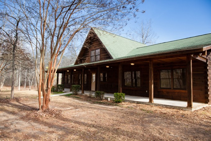 Lovely Exterior Design Of Southland Log Homes With Olive Roof And Single Hung Glass Windows Plus Door Ideas