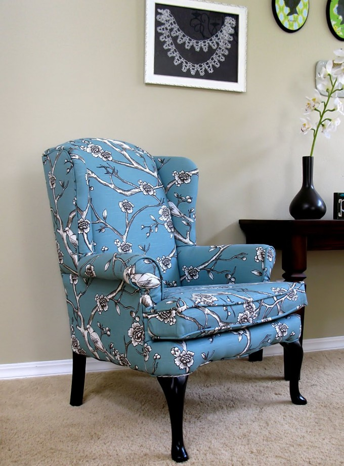 Luxury Single Sofa With Wingback Chair Slipcover In Blue And Floral Motif With Black Wooden Legs On Beige Rug Matched With Beige Wall For Living Room Decor Ideas