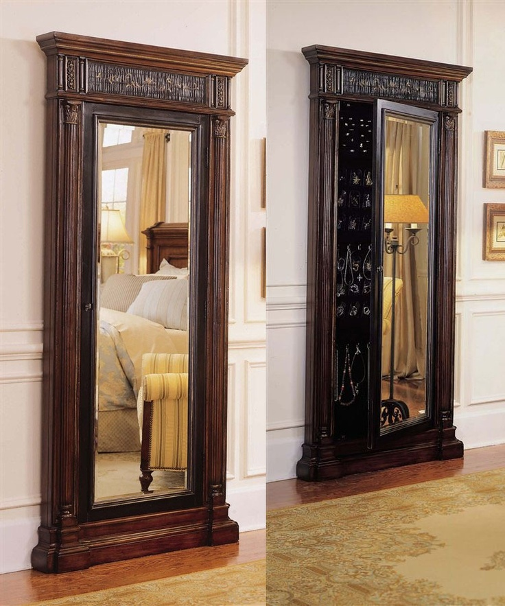 Luxury Wooden Standing Mirror Jewelry Armoire In Dark Brown Before The White Wall With Wainscoting Matched With Wooden Floor For Home Living Decor