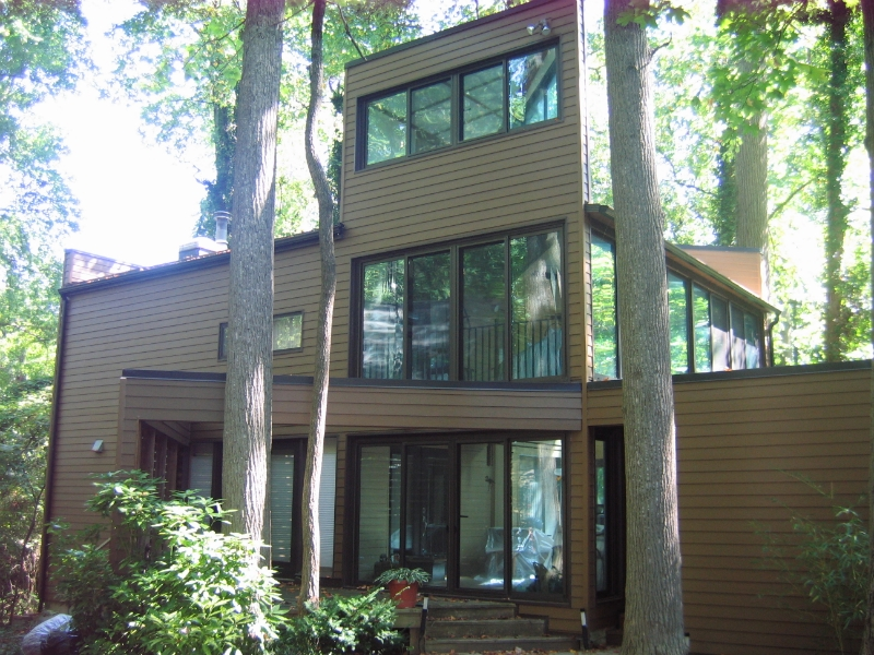 modern house design with horizontal hardie plank siding in tan with glass window ideas