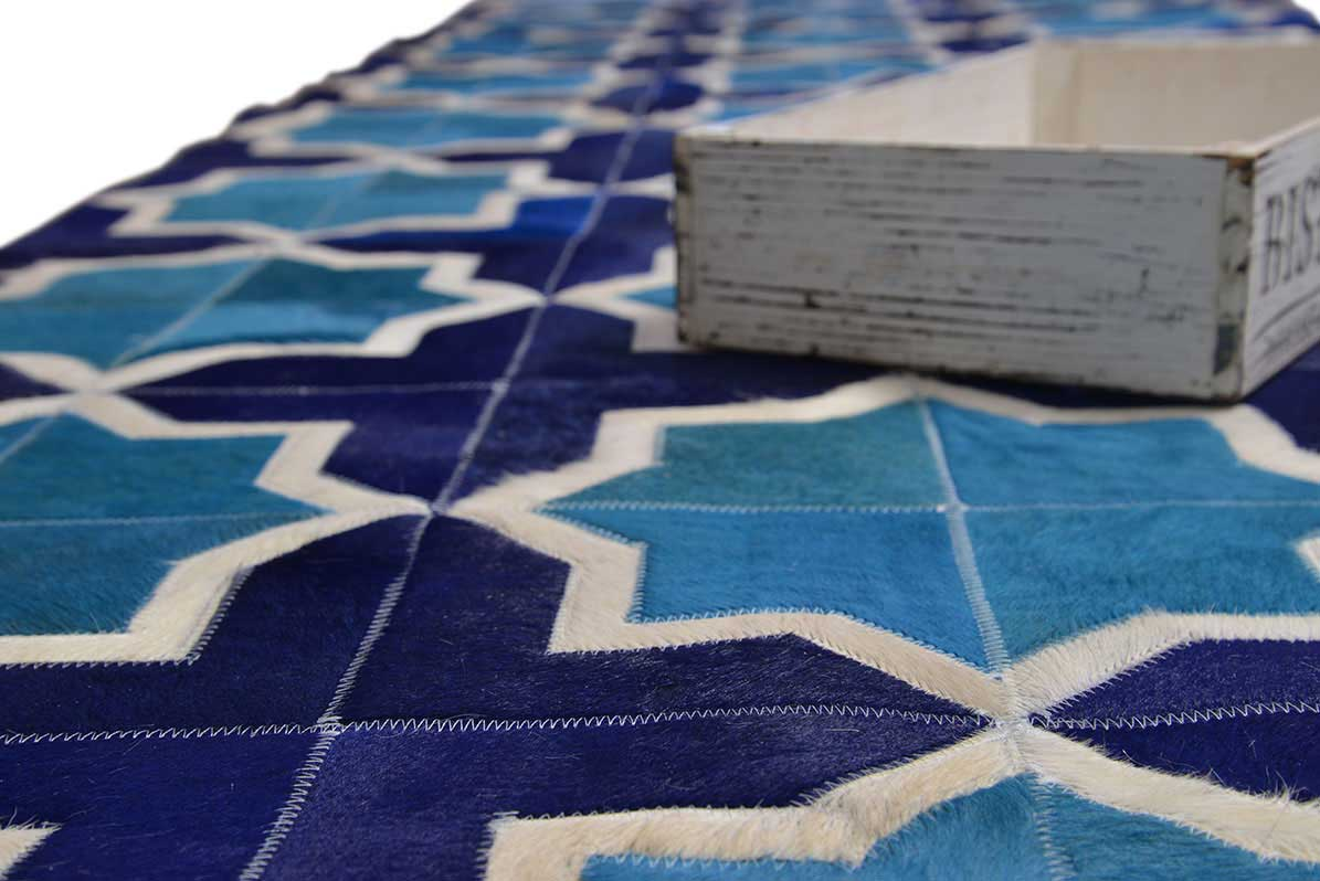 nice cowhide patchwork rug in blue and white with star motif for floor decor ideas